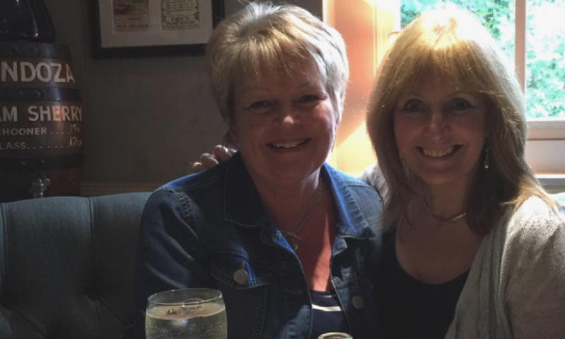 Hilary and Sally-Anne celebrating their reunion in a pub