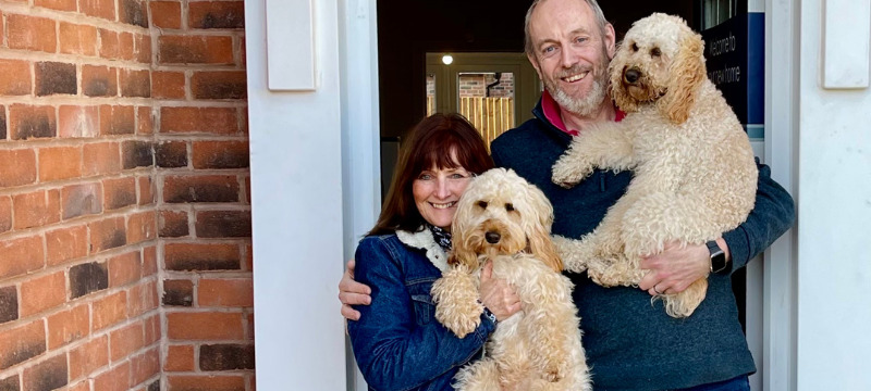Moving house with a dog - Outside our new home with Freya and Frankie