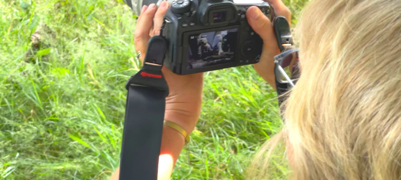 Nicki Cameron taking an image of Freya and Frankie and checking the image on her camera